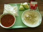 meat sauce with noodles, cabage sautee, two slices of melon