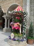 A flower statue of Minnie Mouse