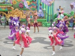brightly colored dancers