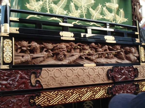 detail of the wood carving on the floats