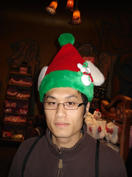Jun is styling one of the Christmas hats you can buy